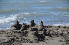 Castle of sand. Castle made of sand on the  sea (France Royalty Free Stock Photography