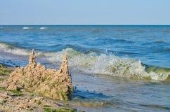 Castle of sand on the sea beach, horizon. stock image