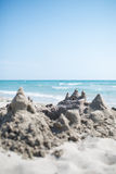 Castle of sand. At sea coast stock images