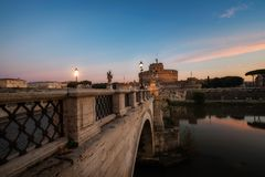 Castle Sant Angelo, bridge Sant Angelo and river Tiber in the ra. Ys of sunrise in Roma, Italy. Rome architecture and landmark. Rome cityscape stock photo
