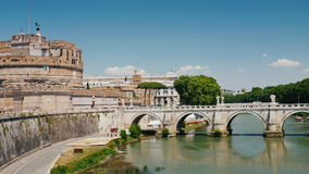 The castle of Sant`Angelo in Rome and the bridge over the Tiber River on a clear summer day stock footage