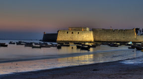 Castle of Santa Catalina at sunset. Castle of Santa Catalina located in Cadiz on the beach of the Caleta on the evening Royalty Free Stock Images