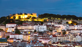 Castle Sao Jorge and Lisbon downtown, night. Historic mediterranean architecture with with castle  Sao Jorge and church at night with light in Lisboa, Portugal Royalty Free Stock Photography