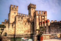 Castle of Scaligers on shore of Lake Garda in resort town of Sirmione, Italy. royalty free stock image