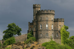 Castle in Scotland. Castle on a hill in Edinburgh, Scotland. Shot on an overcast day just as the sun came out behind me and illuminated the castle royalty free stock photography