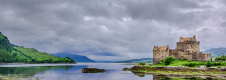 Castle in Scotland. Lake and mountains: Eilean Donan Castle in Scotland stock photo