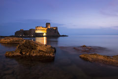 Castle in the sea in Le Castella town, Calabria, Italy. The wonderful castle of Le Castella, in Calabria (Italy) at sunset on a summer evening. The castle is Royalty Free Stock Photography