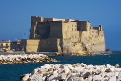 Castle on the sea in Naples. Castel dell'Ovo (Egg Castle) a medieval fortress in the bay of Naples, Italy Royalty Free Stock Photography