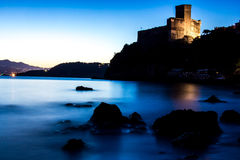 Castle on the sea. At sunset in Italy Gulf of Poets La Spezia royalty free stock images