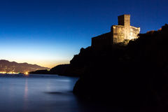 Castle on the sea at sunset in Italy. Gulf of Poets La Spezia royalty free stock image