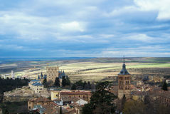 Castle of Segovia, a tower and old medieval buildings with fields at the baackground Royalty Free Stock Image