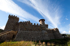 Castle Side. A stone castle with hilly mountains in the background Royalty Free Stock Photo