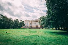 Castle side on green lawn stock photography