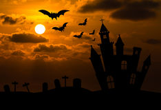 Castle silhouette in Halloween night stock photography