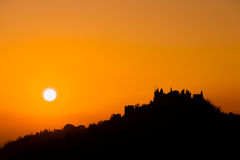 Castle silhouette at sundown Stock Images