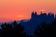 Castle silhouette at sundown. Italian panorama from `Marostica`. Orange sky Stock Photography