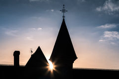 Castle Silhouette before the Sunset. Castle Silhouette with Sun Star in Blue Sky before the sunset royalty free stock image