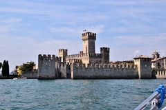 The castle of Sirmione on Lake Garda. Seen from the lake Royalty Free Stock Photo