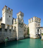 Castle of Sirmione. The town of Sirmione in the Lombardy region (northern Italy) is located on a peninsula in Lake Garda. The town is most famous for its thermal Stock Images