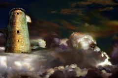 Castle in the sky. Castle tower in sky surrounded by clouds Royalty Free Stock Photos