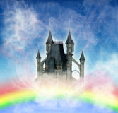 Castle in the sky. Fairytale castle on a blue cloudy background with rainbow Stock Photography