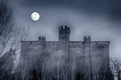 Castle. Spectral castle at night, with full moon in the sky, horizontal image stock photography