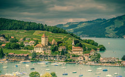 Castle in Spiez Switzerland. View on beautiful small city, lake Thun, marine and many boats. City of Spiez, canton Bern, Switzerland Royalty Free Stock Photos
