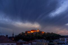 Free Castle Spilberk Brno City Slow Moving Clouds Captured Just From Castle Turn Public Light On Going From Blue Hour To Night Time Stock Photography - 186897552