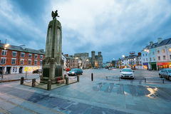 Castle Square in Caernarfon. Caernarfon, UK - February 24, 2017: Evening view of the Castle Square in Caernarfon. In the foreground is a War Memorial and on the Royalty Free Stock Image