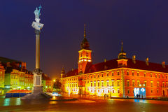 Castle Square at night in Warsaw, Poland. Royal Castle and Sigismund Column at Castle Square illuminated in Warsaw Old town at rainy night, Poland royalty free stock image