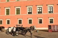 Castle square in Warsaw, Poland - sightseeing hansom. Castle Square in the historical center of Warsaw, Poland - hansom ready for tourists stock photography