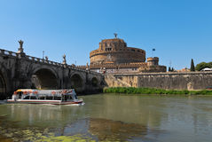 Castle St. Angel with the boat on the Tiber Royalty Free Stock Photography