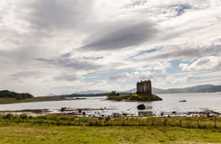 The Castle Stalker, Highlands, Scotland, United Kingdom. Castle Stalker Scottish Gaelic: Caisteal an Stalcaire is a four-story tower house or keep picturesquely Royalty Free Stock Photos