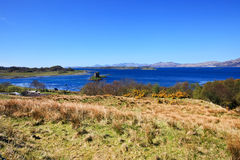 Landscape view to Castle Stalker in Scotland Stock Images