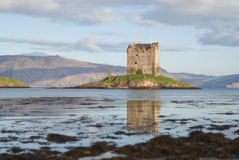 Castle Stalker at sunrise. Castle Stalker lies north of Oban, Scotland. It is situated on an island and can be reached by boat only Royalty Free Stock Images