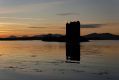 Castle Stalker in twilight. Castle Stalker lies north of Oban, Scotland. It is situated on an island and can be reached by boat only Royalty Free Stock Image