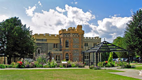 Castle stately home. Photo of a magnificent castle stately home set in beautiful gardens with pergola royalty free stock photo