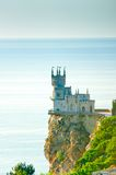 Castle on a steep cliff by the sea Stock Image