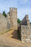 Castle stone tower and wall in Santiago do Cacem Royalty Free Stock Image