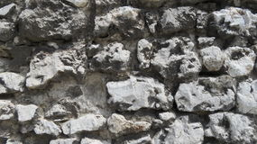 Castle Stone. Stone wall fragment from an old medieval castle wall Stock Images