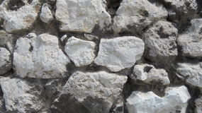 Castle Stone. Stone wall fragment from an old medieval castle wall Stock Image