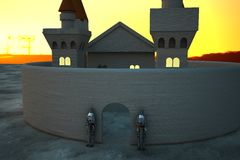 Castle in sunset light with armors in defense of door Stock Photo