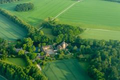 The castle is surrounded by fields, the view from the top of the troposphere stock photography