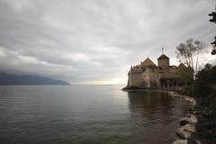 Castle at Switzerland and wonderful lake, travel destination at Lake Geneve, ancient historical landmark medival. Castle at Switzerland and wonderful lake Stock Photography