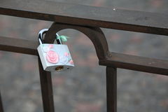 Castle, a symbol of love and fidelity, hanging on the iron bars. Lock a symbol of love and fidelity, hanging on the iron bars. Tradition to hang a castle in Stock Photo
