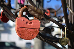 Castle, a symbol of love and fidelity, hanging on the iron bars. Pink, rusty lock a symbol of love and fidelity, hanging on the iron bars Stock Images