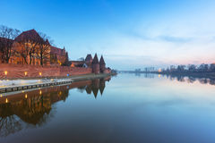The Castle of the Teutonic Order in Malbork. At dusk, Poland Royalty Free Stock Images
