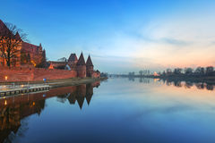 The Castle of the Teutonic Order in Malbork. At dusk, Poland Stock Photography