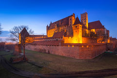The Castle of the Teutonic Order in Malbork. At dusk, Poland Stock Photo