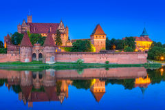 Castle of the Teutonic Order in Malbork at night Stock Photo